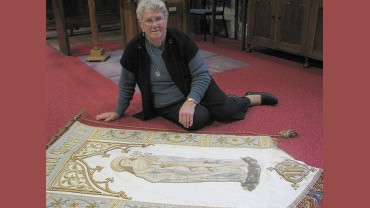 Mary Vinnicombe with the St Mary banner